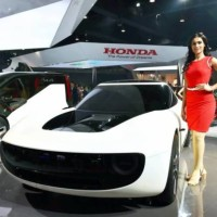 RPT with correction...Greater Noida: A model poses next to a concept car at auto major Honda's stall at the Auto Expo 2018 in Greater Noida on Wednesday. PTI Photo by Vijay Verma     (PTI2_7_2018_000022B)