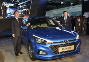 Greater Noida: Hyundai Motor India Ltd (HMIL) MD and CEO YK Koo (R), along with a company official, showcases  premium compact hatchback Elite i20 at Auto Expo 2018 in Greater Noida, Uttar Pradesh on Wednesday. PTI Photo by Kamal Singh  (PTI2_7_2018_000040A)